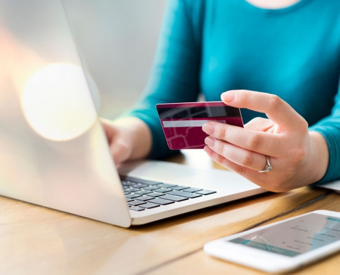 Get paid Digiteal - Woman holding bank card